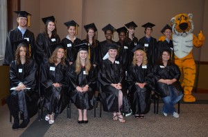 The group of MU High School graduates who attended the ceremony in person pose a graduating class.
